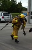 Firefighting pulling a hose